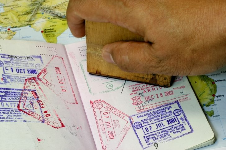 Immigration Stamp on Passport in a map background