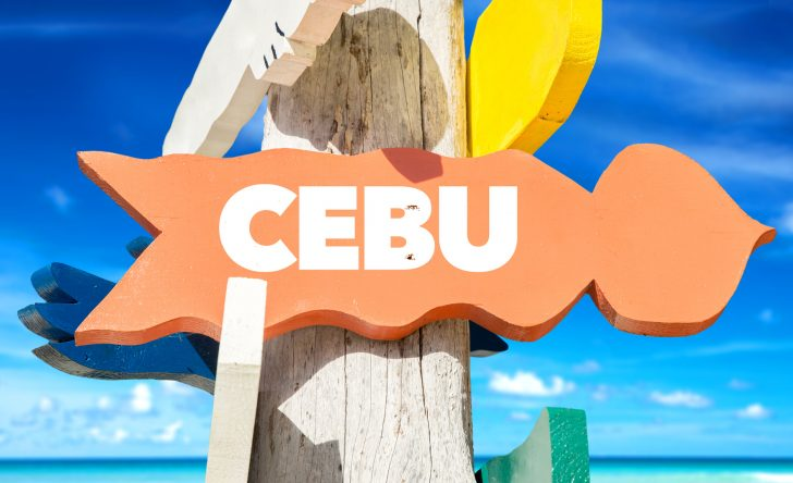 Cebu signpost with beach background
