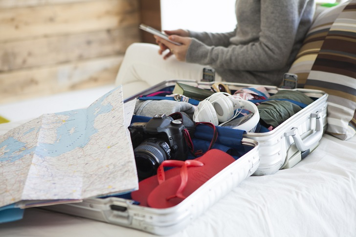 Women are getting ready to go on a trip, are searching in the smartphone